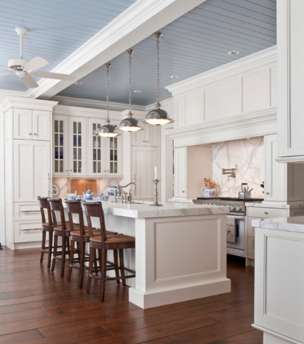 White classic kitchen with coloured ceiling and nautical lighting.